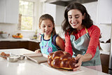 Mother and daughter in kitchen with freshly baked challah