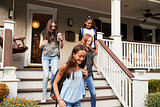 Four teen girlfriends leaving house for school