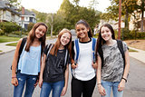 Teen girls on the way to school looking to camera, close up