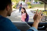 Father In Car Dropping Off Daughter In Front Of School Gates