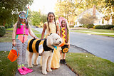 Children And Dog In Halloween Costumes For Trick Or Treating