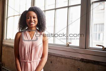 Smart young black businesswoman smiling to camera