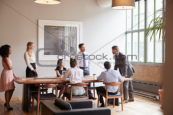 Young professionals around a table at a business meeting