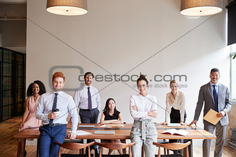 Young professionals at a business meeting looking to camera