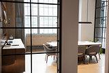 Empty boardroom at a business seen through open door