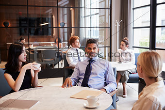 Business colleagues talking at their office cafe