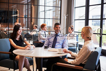 Business colleagues relaxing at their office cafe