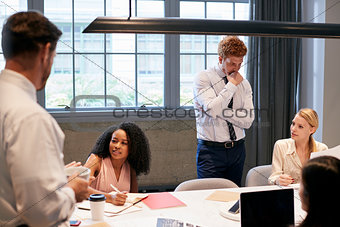 Business colleagues brainstorming together in a meeting room