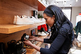 Young woman looking at shoes on display in a shop, close up