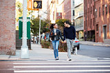 Young Hispanic couple walk hand in hand in Brooklyn street