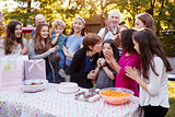Friends and family gathered  at a garden birthday party