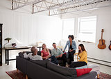 Five young friends socialising in a New York loft apartment