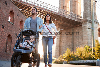 Young family with a daughter taking walk on street, close up