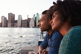 Young black couple standing on quayside, close up