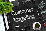 Customer Targeting - Text on Black Chalkboard. 3D Rendering.