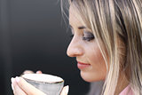 woman drinking coffee in the morning at restaurant soft focus on the eyes
