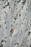 man rock climber climbs on the cliff