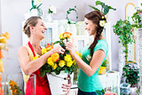 Florist woman and customer in flower shop