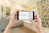 Hands Holding Smart Phone with Master Bathroom Drawing on Screen