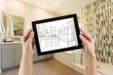 Hands Holding Computer Tablet with Master Bathroom Drawing on Sc