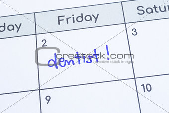 The word Dentist written on calendar page.