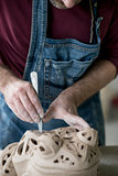 Ceramist Dressed in an Apron Sculpting Statue from Raw Clay in Bright Ceramic Workshop.