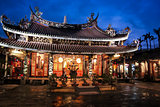 Dalongdong Baoan Temple on rainy night Tapei Taiwan
