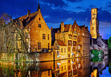 Bruges Belgium evening sunset with blue sky