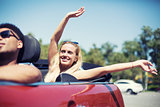 Young woman in cabriolet car departs for the summer holidays