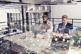Business people that work together in office at the night. Concept of teamwork and partnership. double exposure