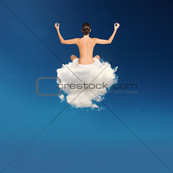 Young girl practices yoga over a cloud