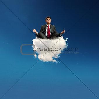Stressed businessman practice yoga on a cloud