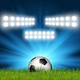 Football / soccer ball under spotlights