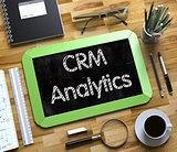 CRM Analytics Handwritten on Small Chalkboard.