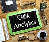 CRM Analytics Handwritten on Small Chalkboard.