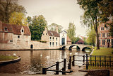 The Minnewater with bridge and entrance portal to the Bruges Beg
