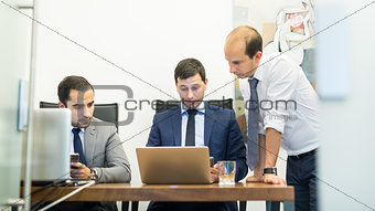 Corporate business team working in modern office.