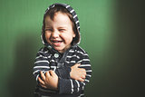 cute kid smiling boy crossing hands in pullover