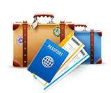 Retro suitcases, passport and airline tickets