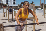 Serious woman working out on shore