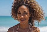 Beautiful ethnic woman in tropical sunshine