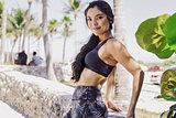 Beautiful sportive woman posing at camera in park