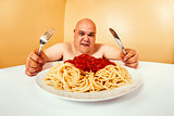 Hungry fat man eating spaghetti