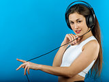 Attractive woman enjoying music with headphones