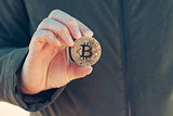 Woman holding Bitcoin BTC cryptocurrency