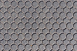 Hexagonal patterned manhole cover background