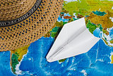 Adventure. Papercraft Plane, Hat on map. Top view. Travel Concept.