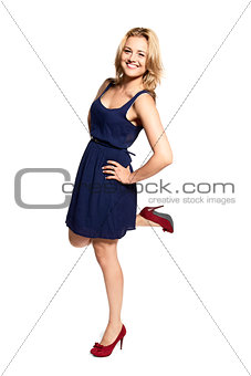 Smiling Young Woman Standing on One Leg