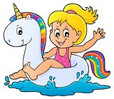 Girl floating on inflatable unicorn 1