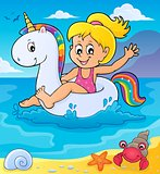 Girl floating on inflatable unicorn 2